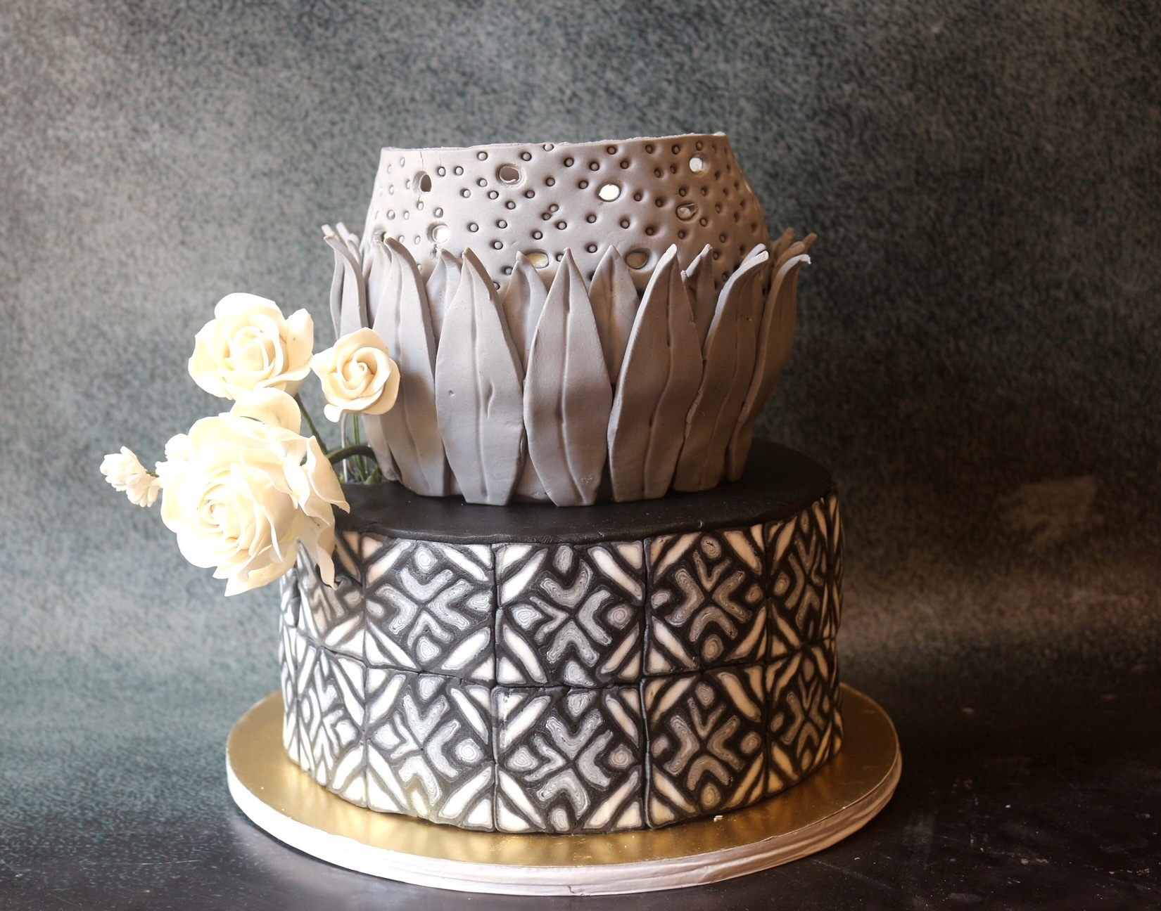 Taupe and gray fondant wedding cake with white flower