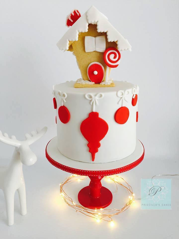 White fondant cake with gingerbread house topper