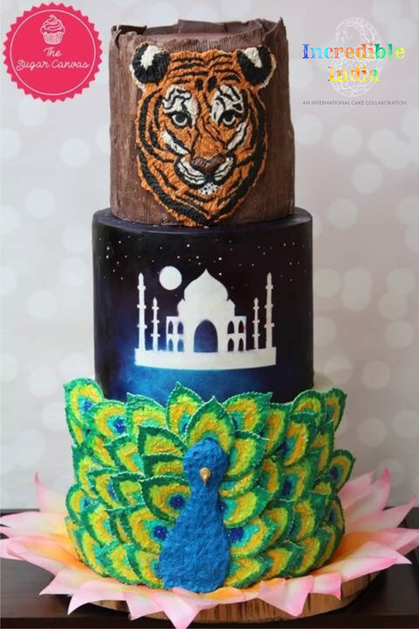 Tiger and peacock themed fondant cake