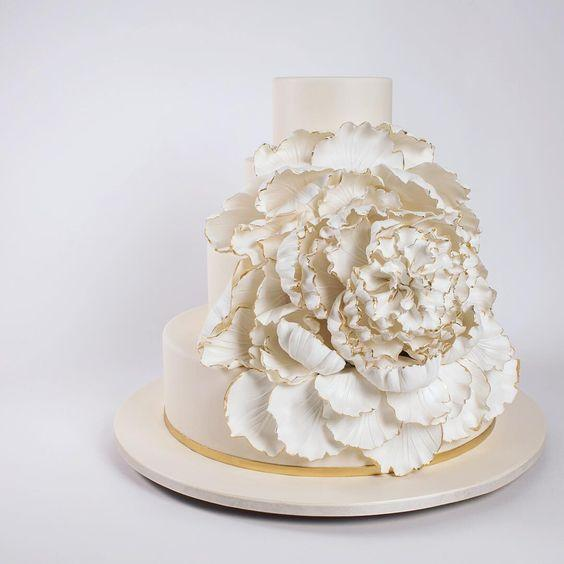 White luxe fondant wedding cake with giant gum paste rosette