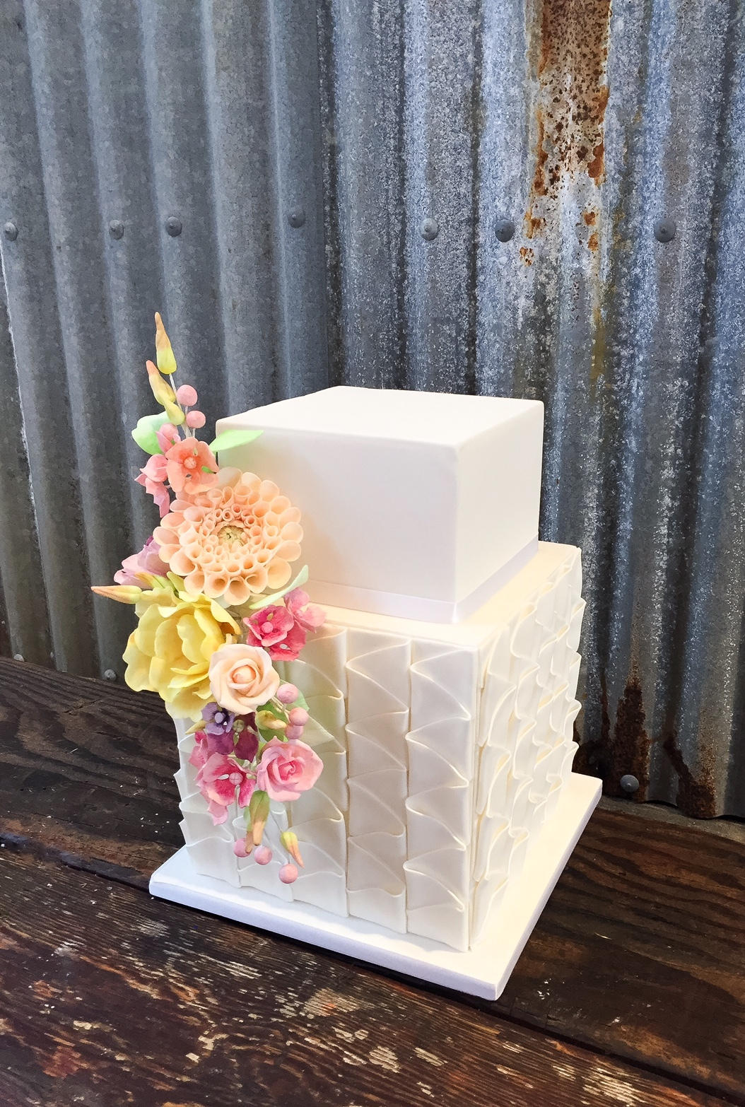 White textured square wedding with sugar flowers