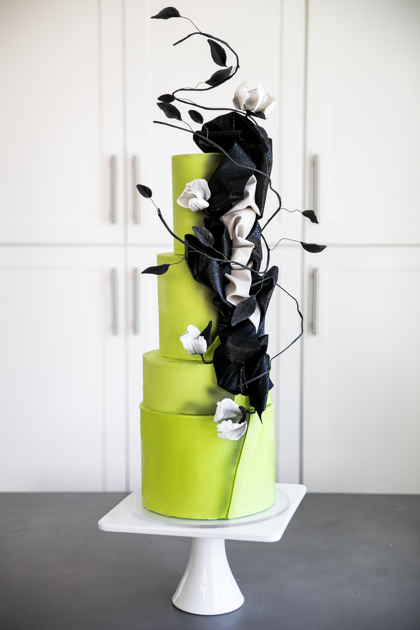 Ultra luxe bright green with black fondant wedding cake