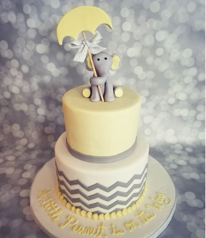Light yellow and gray baby elephant fondant cake
