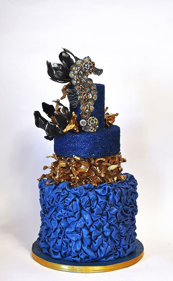 Blue fondant ruffled nautical cake