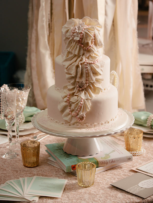 Taupe fondant wedding cake with vertical ruffles