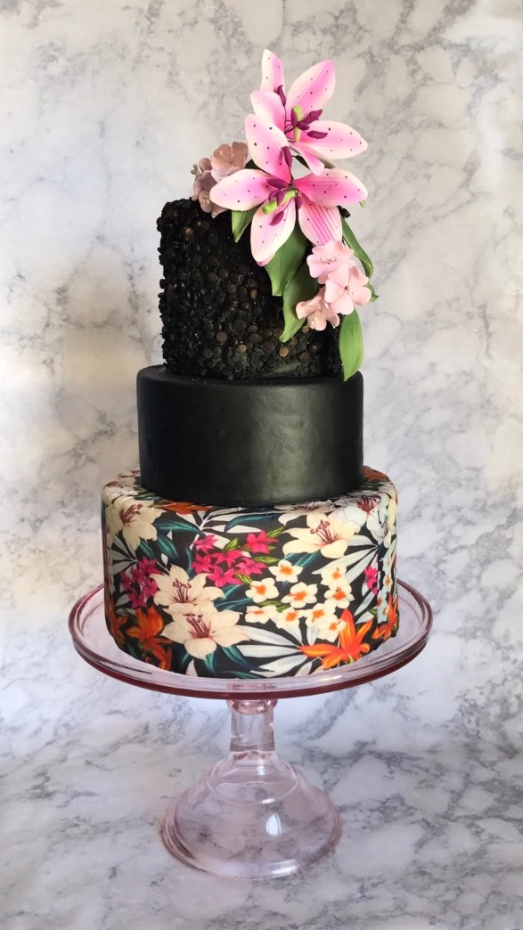 Black wedding cake with handprinted details