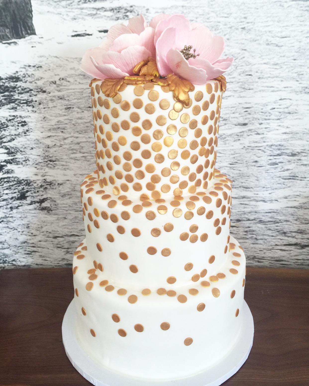 White wedding cake with gold confetti sparkle