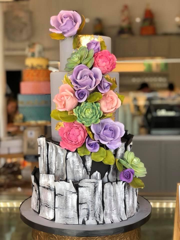 Exposed bark wedding cake with lavender sugar flowers