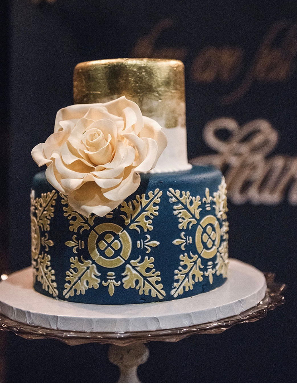 Navy blue wedding cake with gold patterned detailing