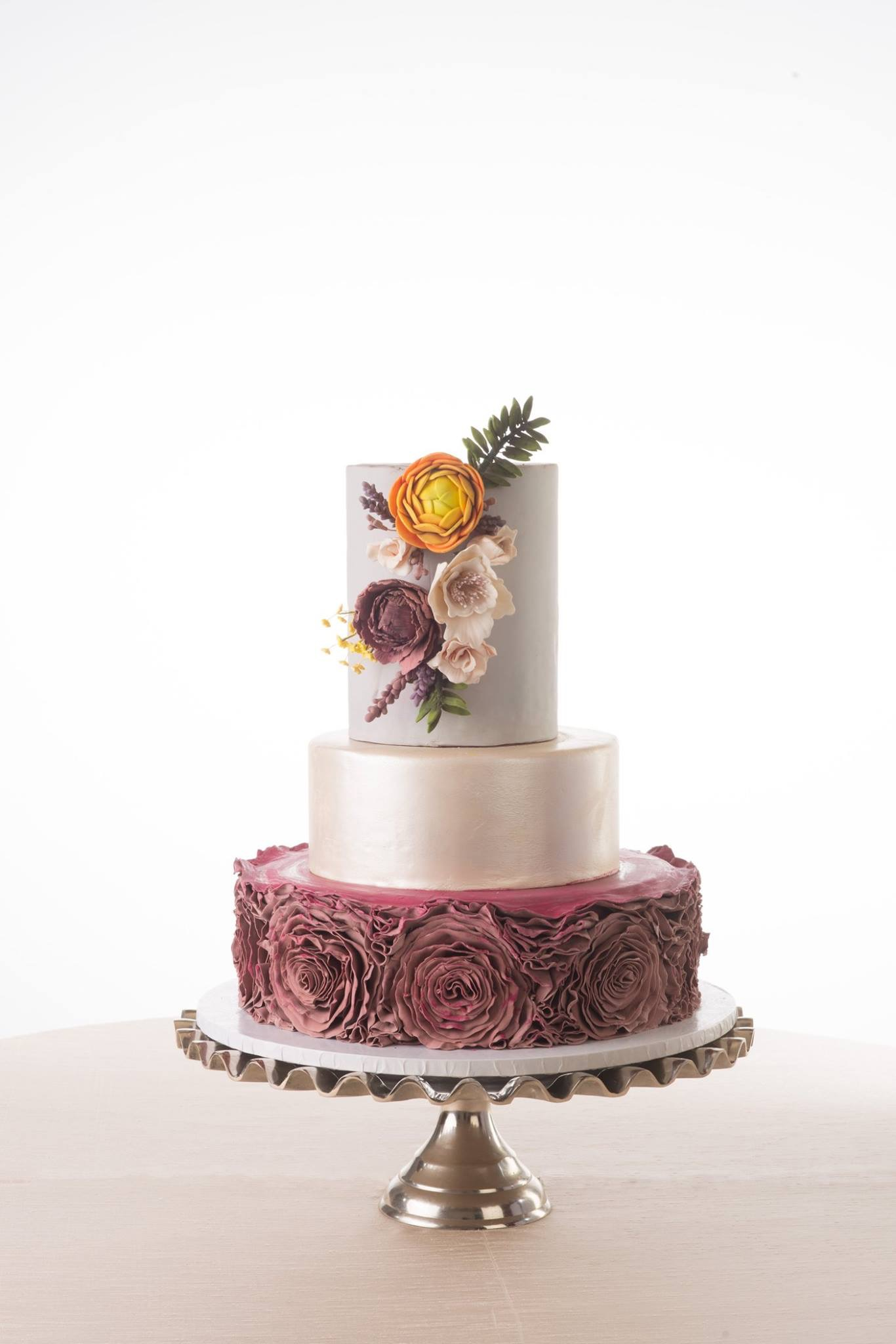 Burgundy rosette wedding cake with silver