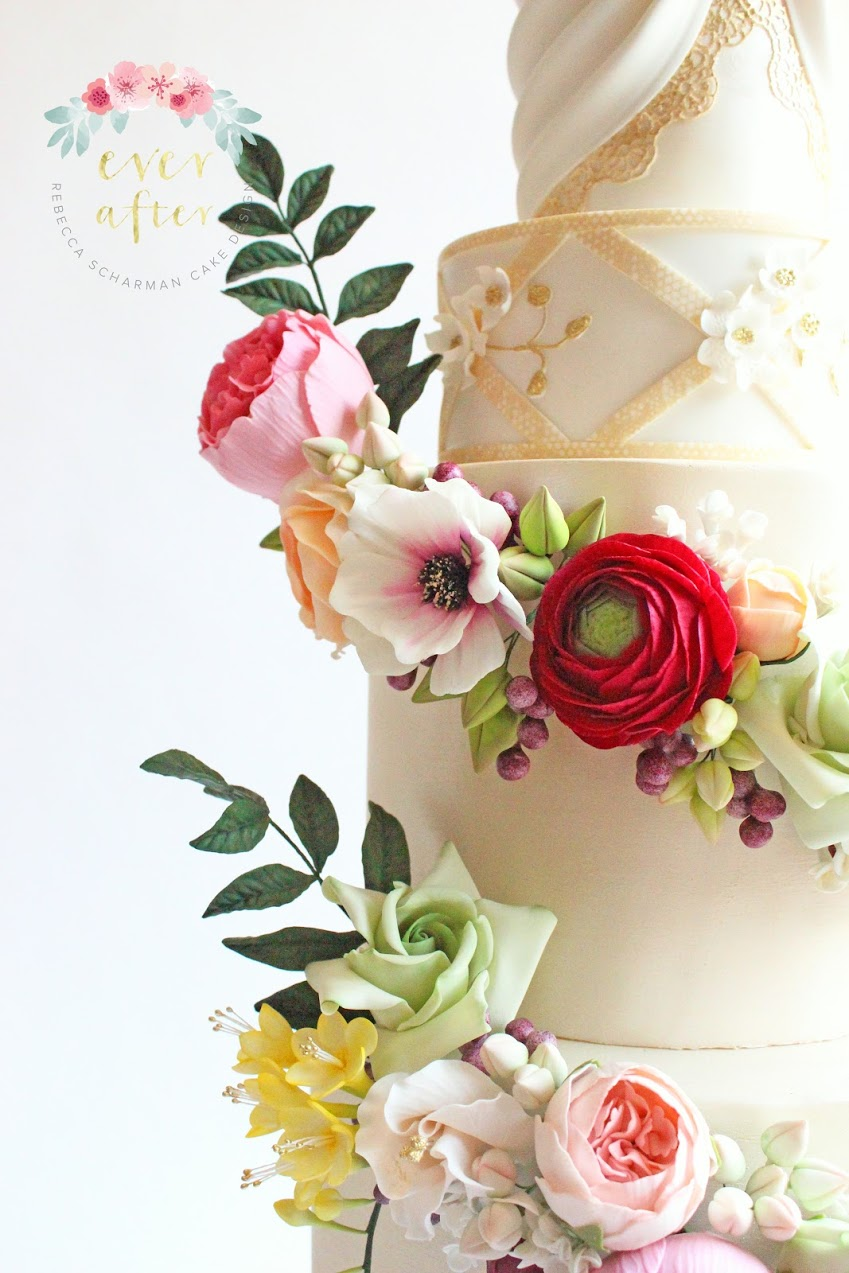 Ivory fondant Wedding cake with cascading gum paste flowers