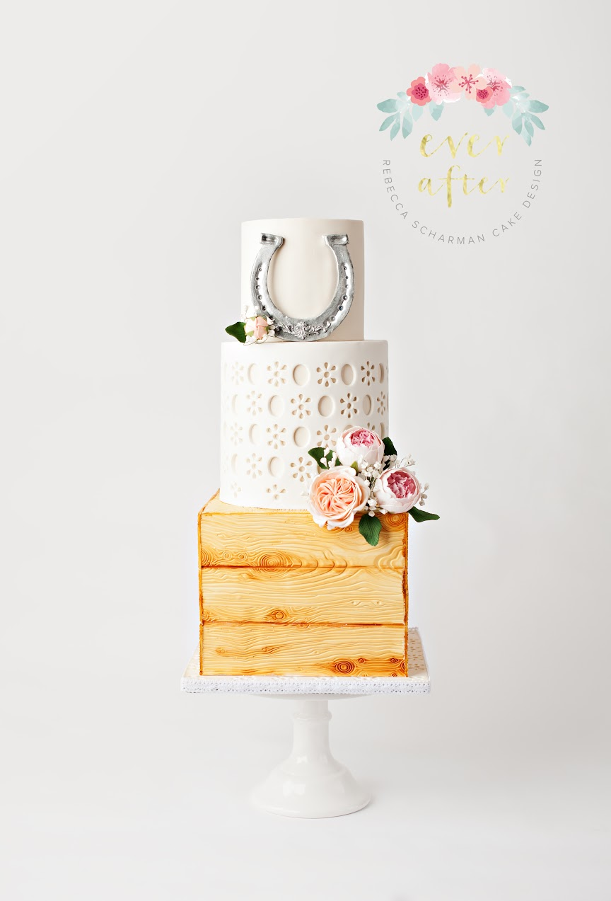 Barn yard inspired fondant wedding cake with horseshoe
