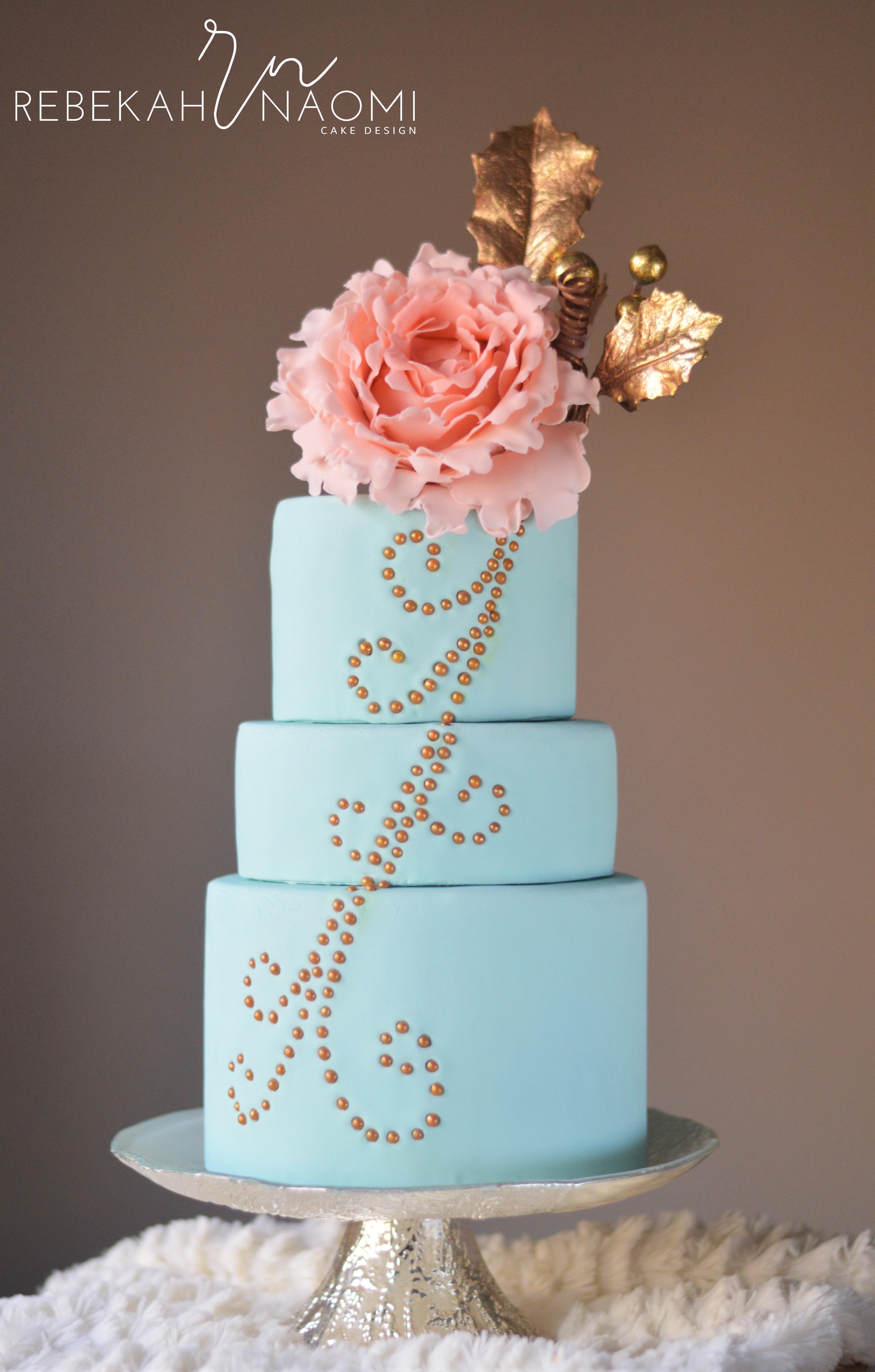 Turquoise fondant wedding cake with peony