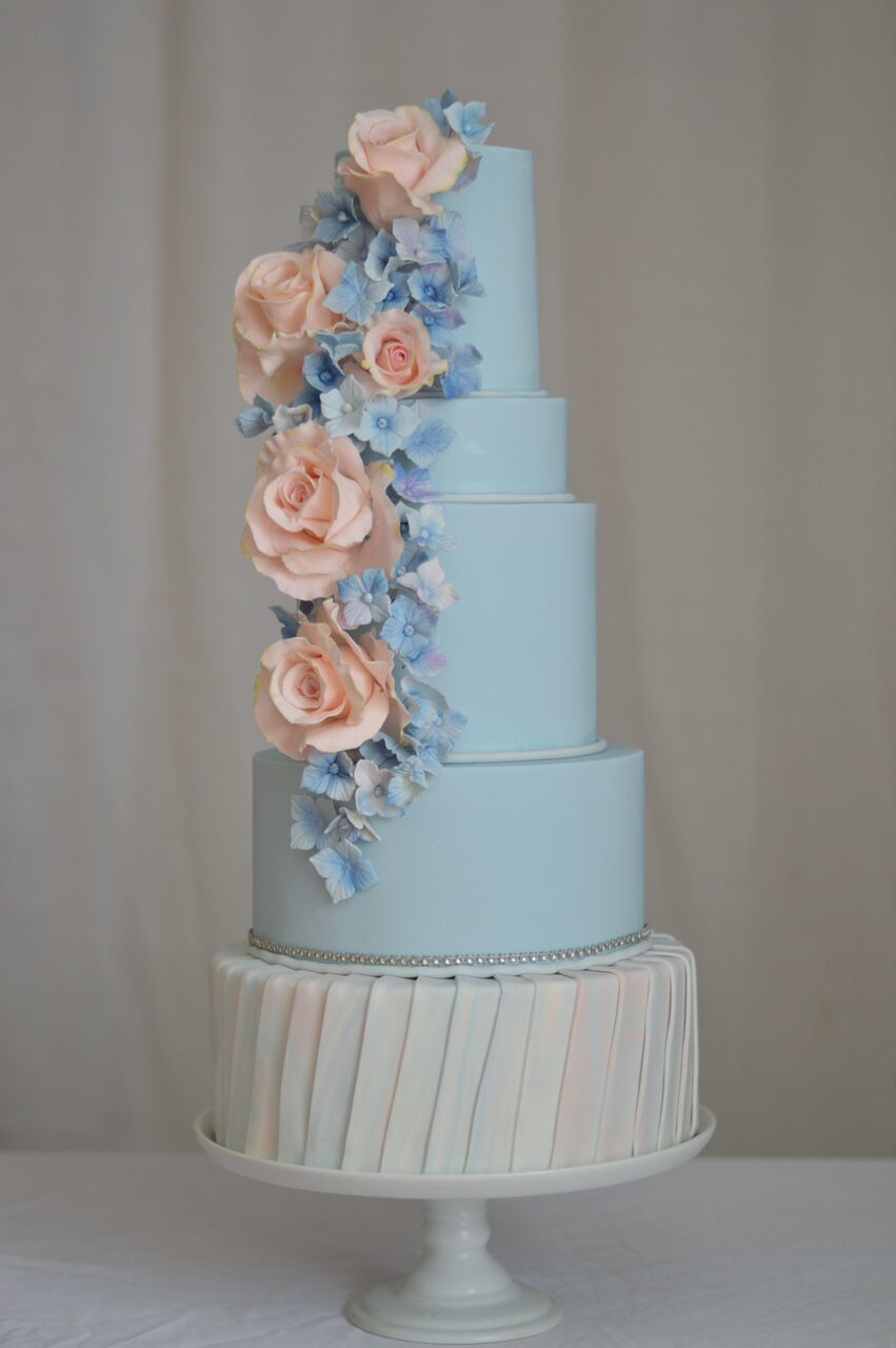 Baby blue wedding cake with light pink sugar flowers