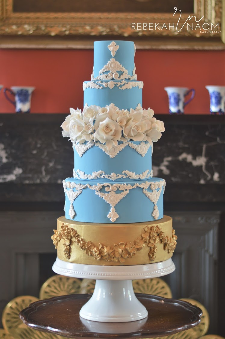 Colonial Inspired Baby blue fondant wedding cake with gold