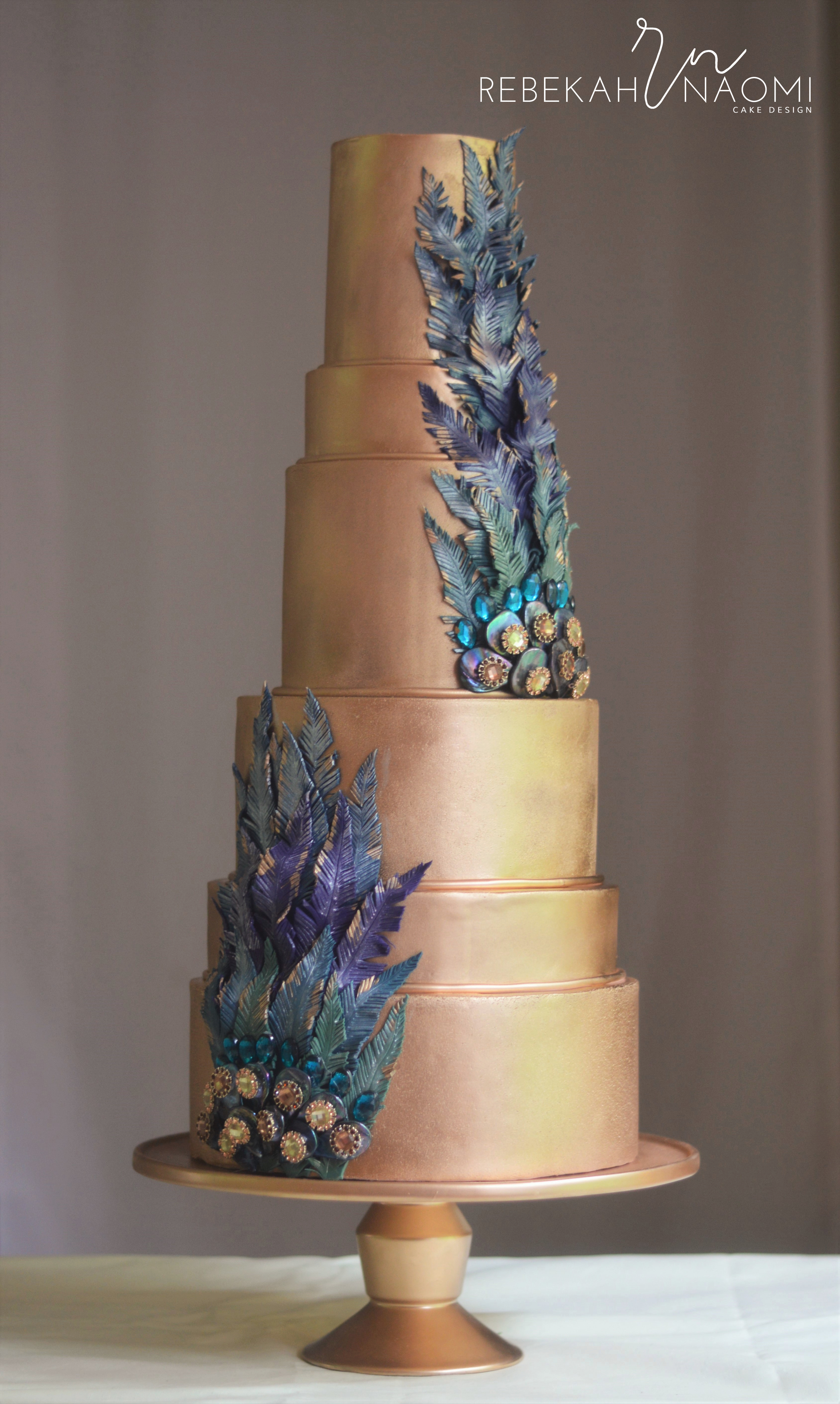 Copper peacock themed wedding cake