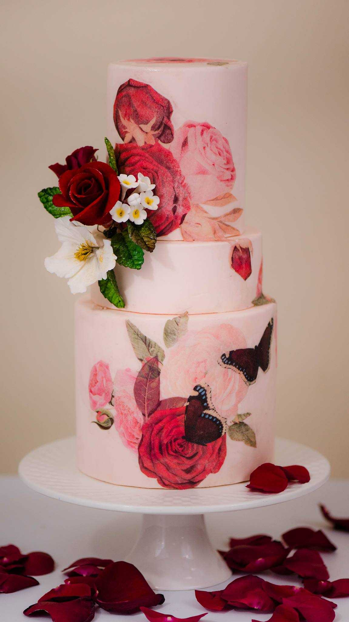Baby pink wedding cake with hand painted pink flowers
