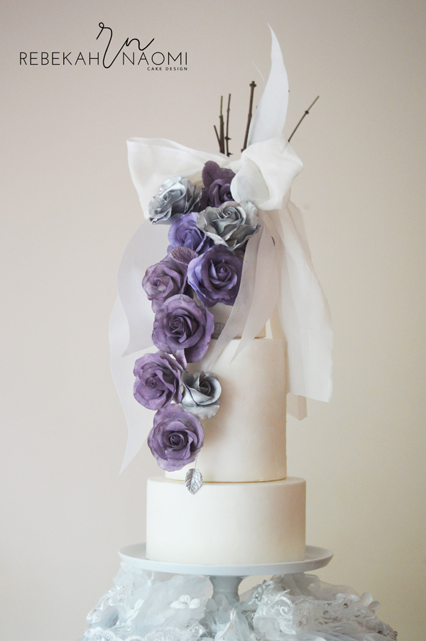 White fondant wedding cake with gum paste purple flowers