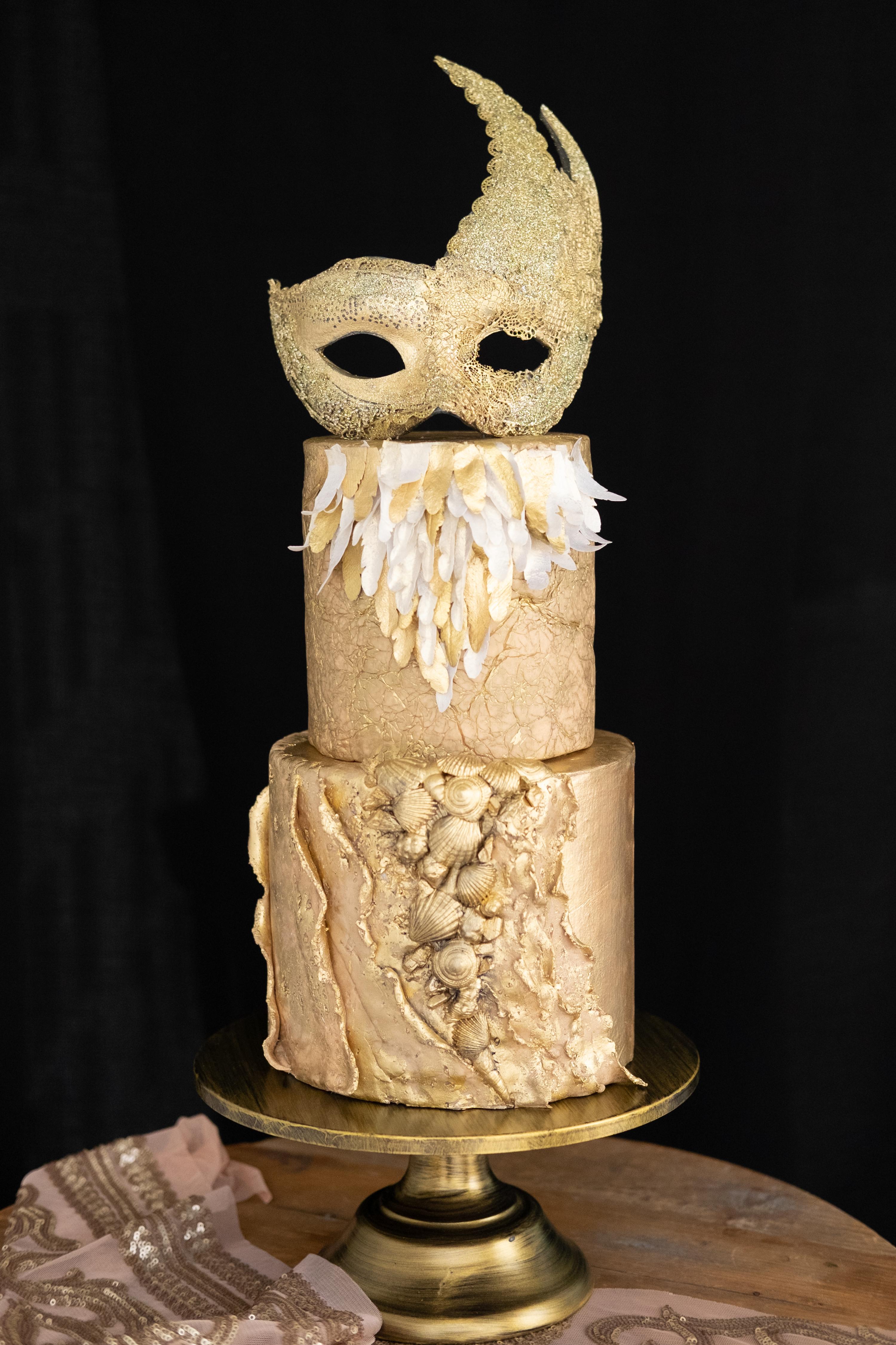Gold fondant masquerade cake