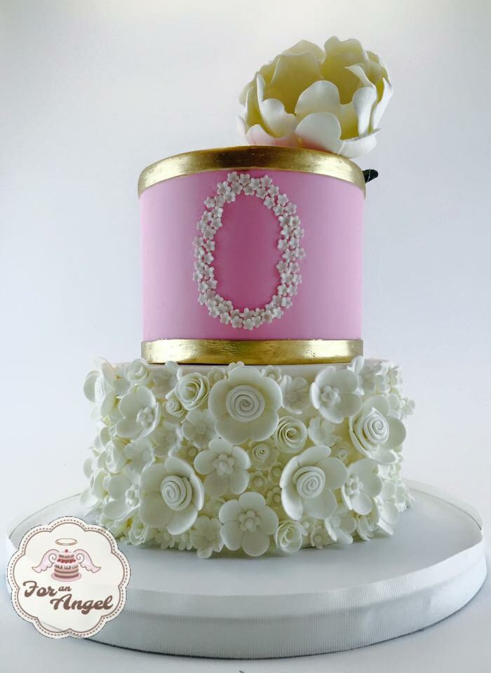 Pink wedding cake with white ruffles