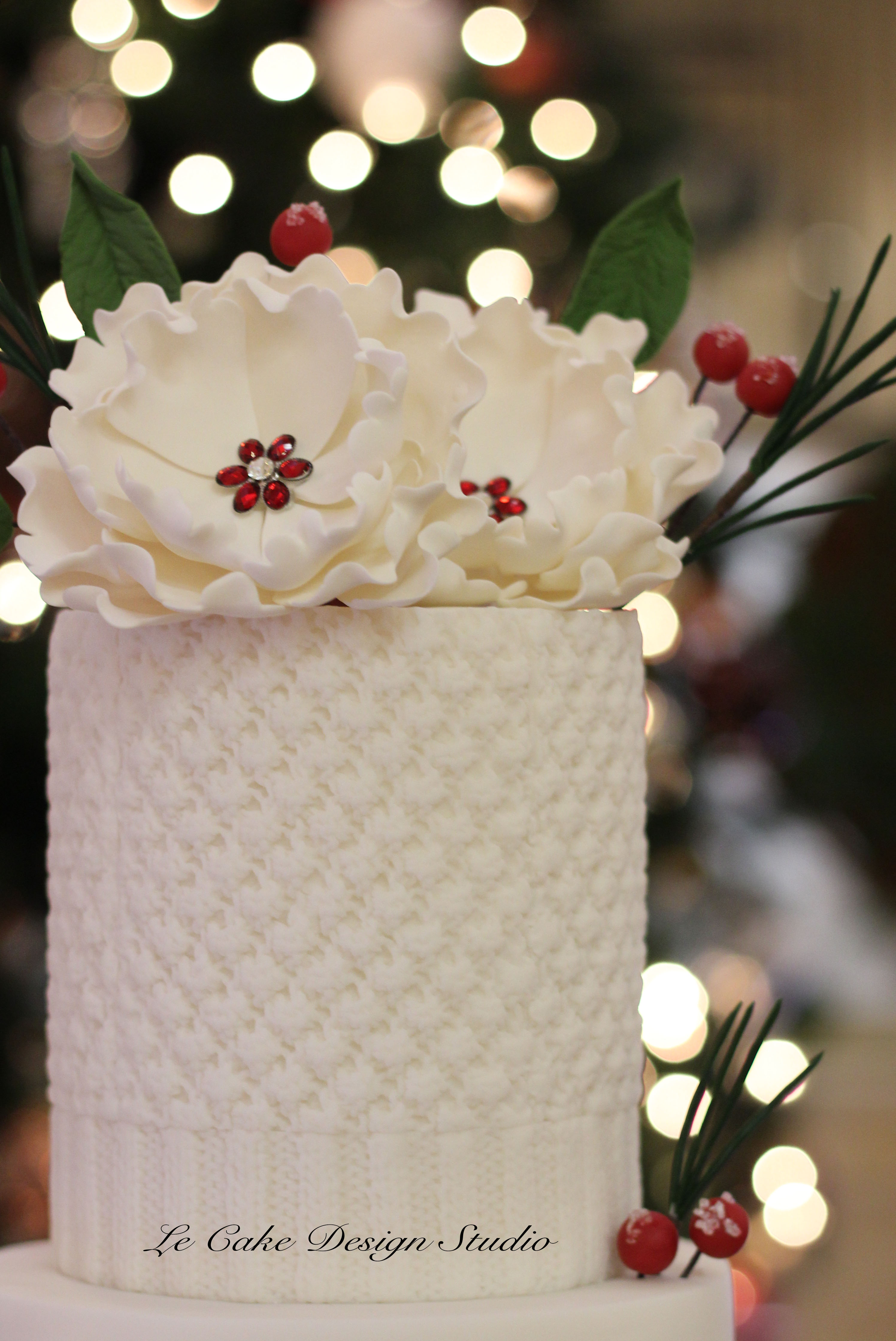 All white elegant winter wedding  cake with cranberry detailing