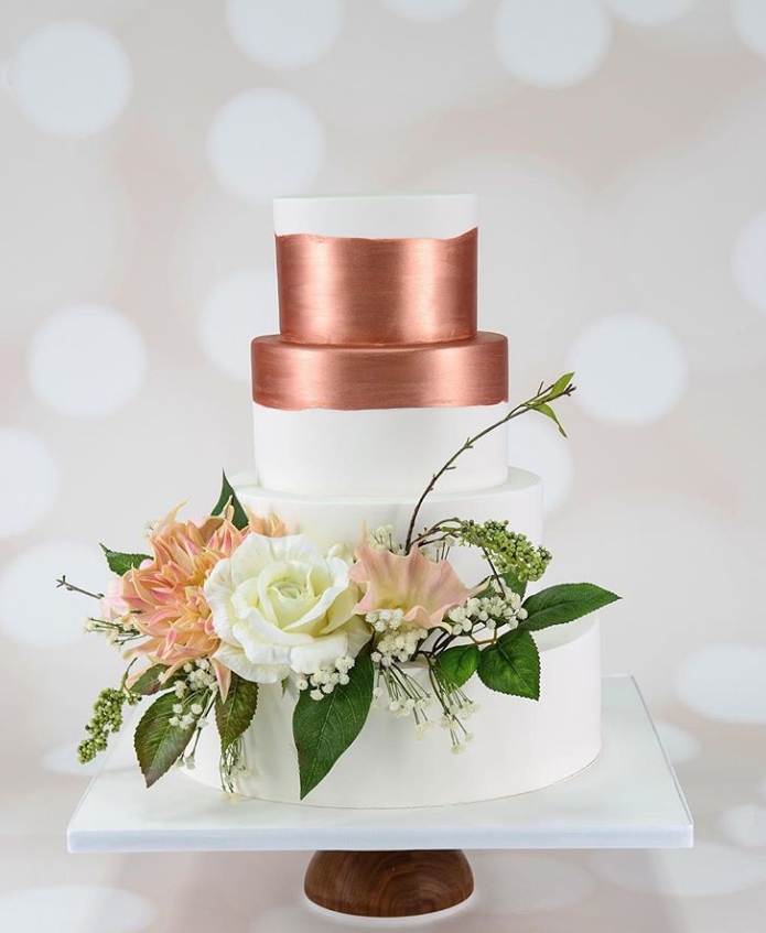 Copper fondant wedding cake with white