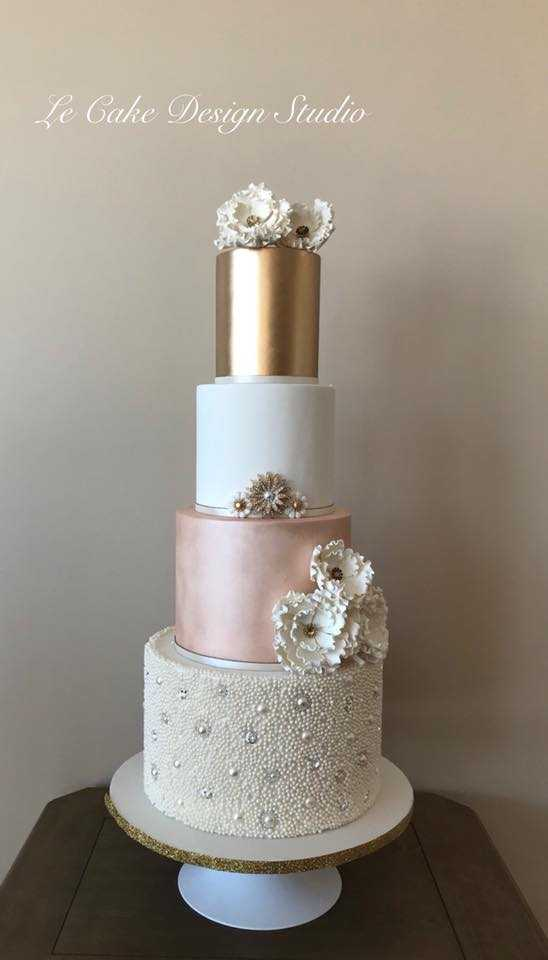 Peach and rose gold fondant wedding cake