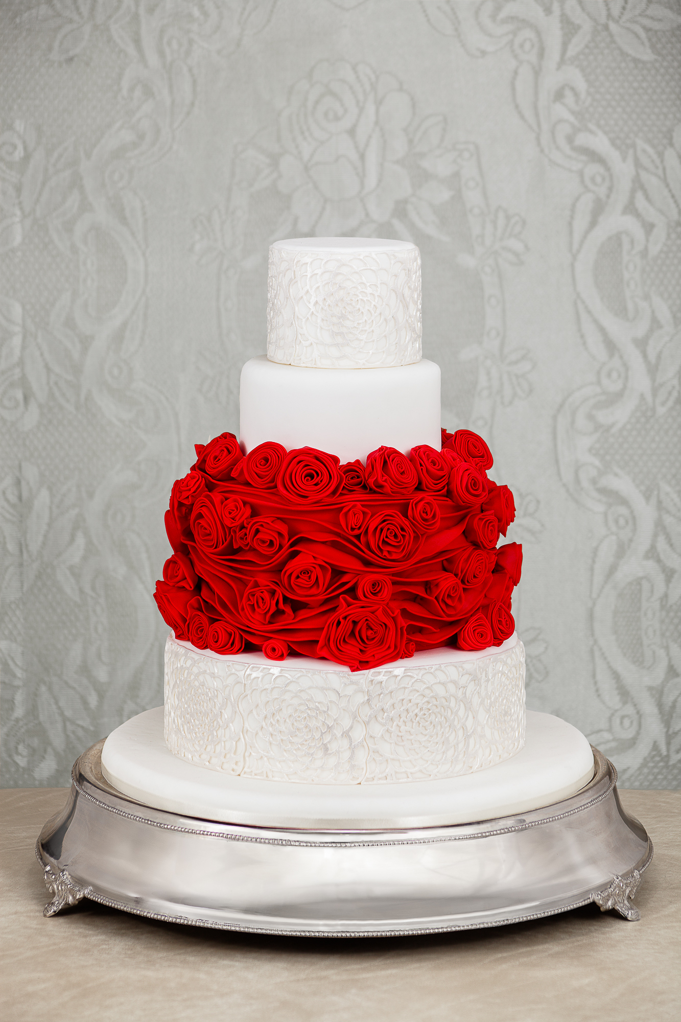 White Wedding with middle tier of Red gum paste roses