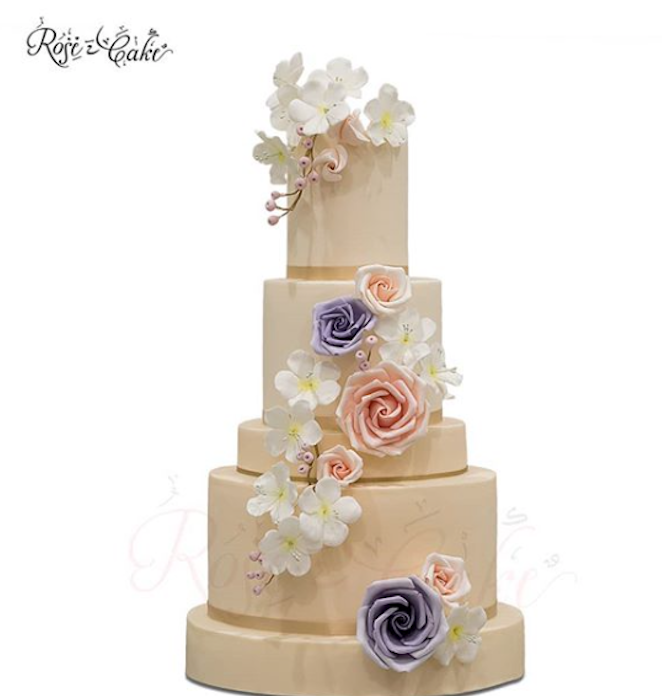 All ivory fondant wedding cake with pastel sugar flowers