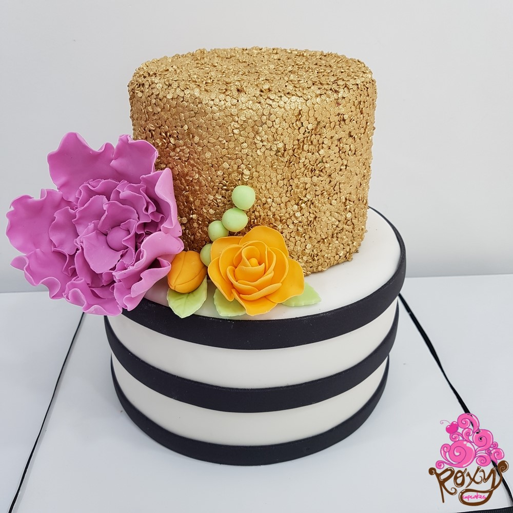 Black and white striped with gold sparkle birthday cake