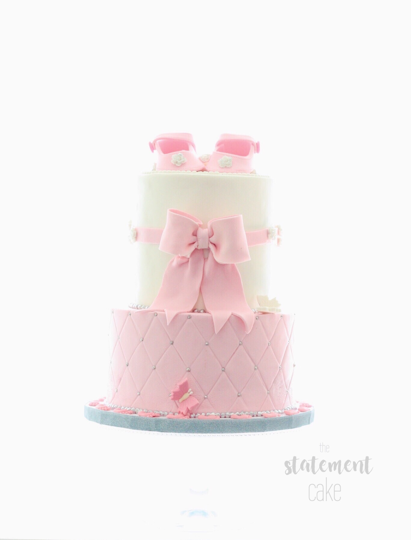 Pink and White baby bow fondant cake