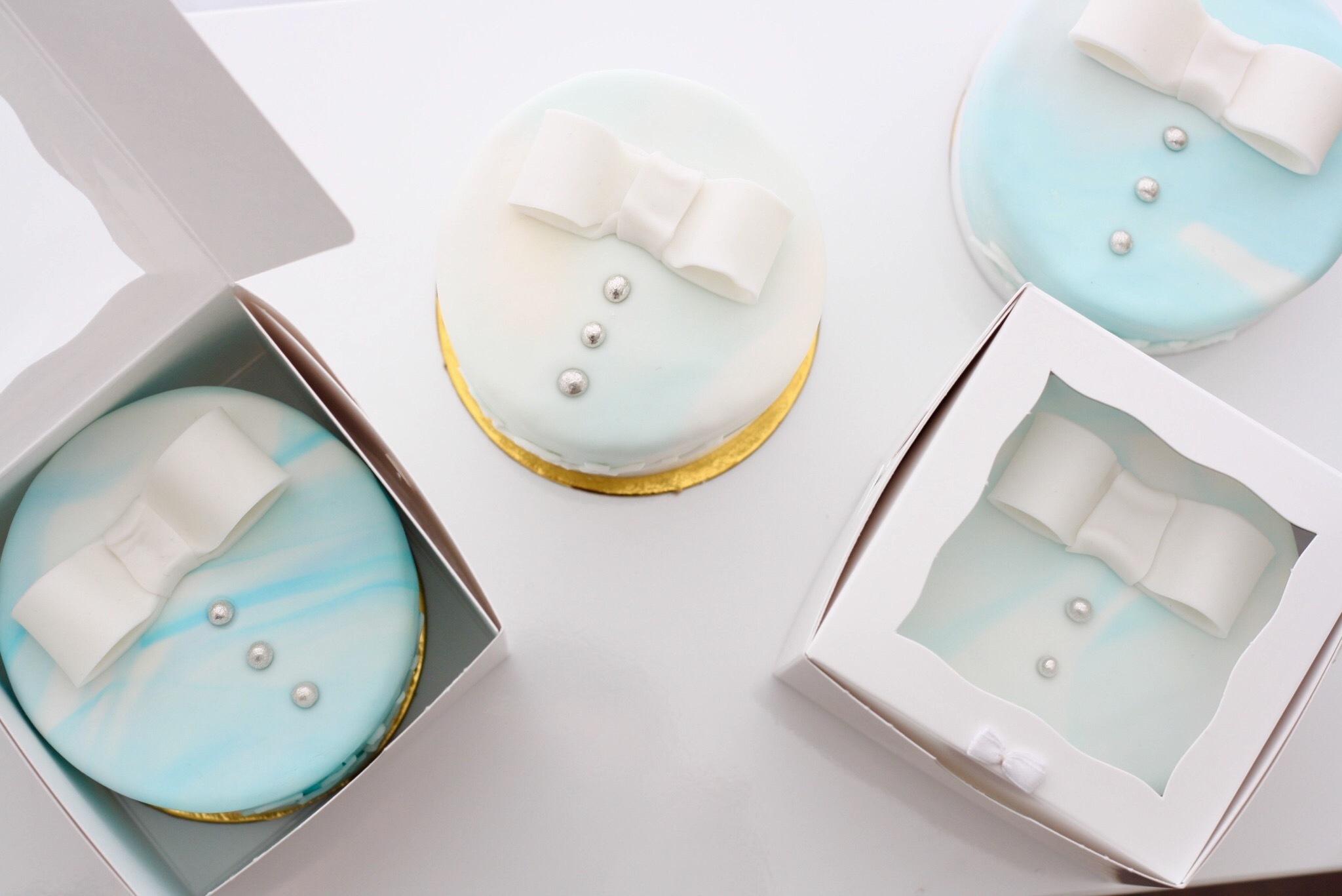 Baby blue bowtie fondant cupcakes