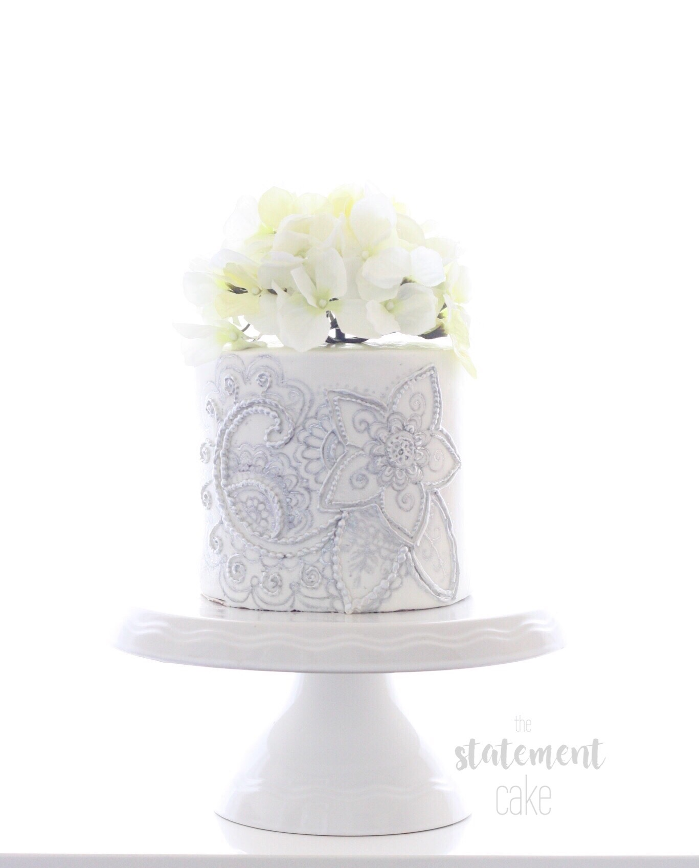 Lavender mini wedding cake with bas relief