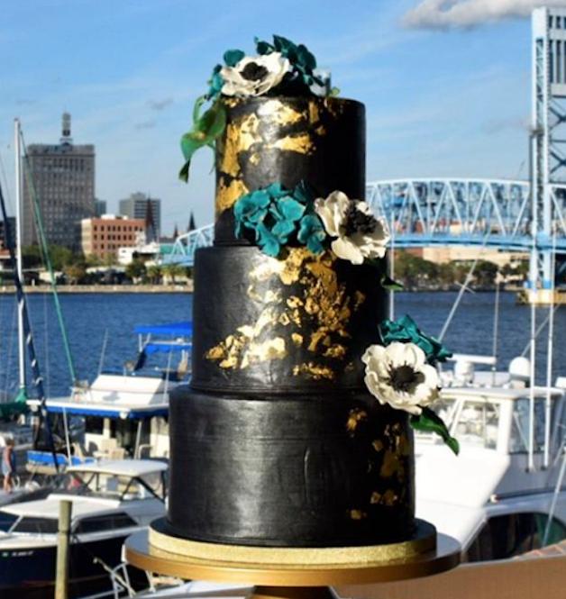 Black with gold fondant wedding cake