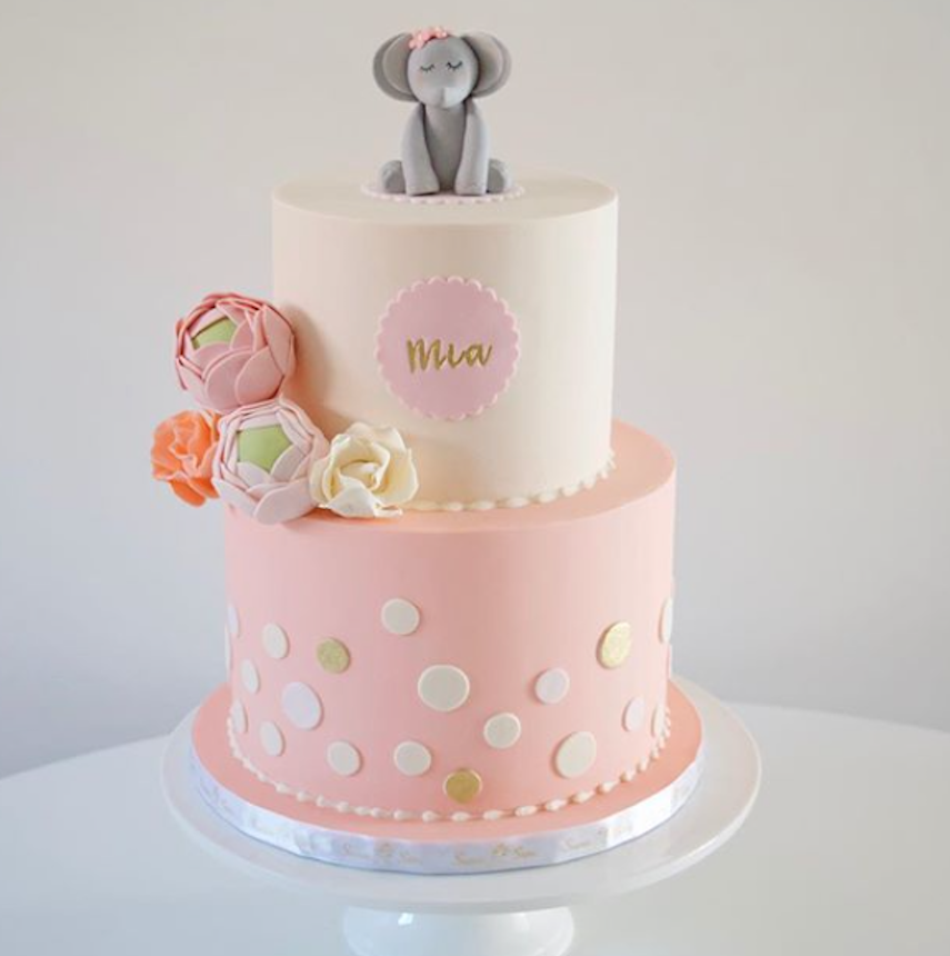 Light pink and ivory fondant cake with elephant topper