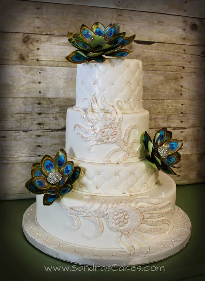 White fondant wedding cake with succulents