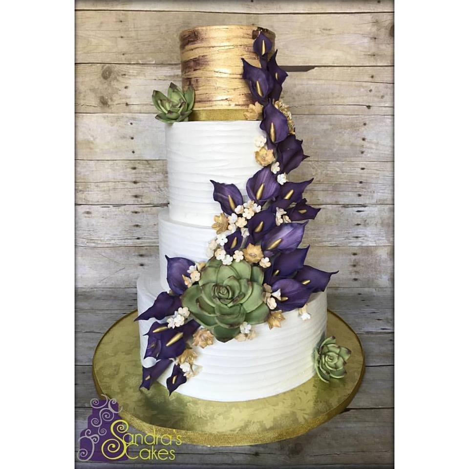 White and gold fondant wedding cake with succulents