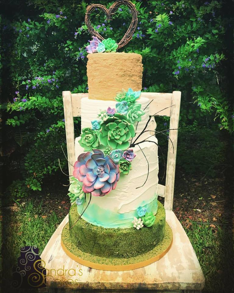 White and green fondant cake with succulents