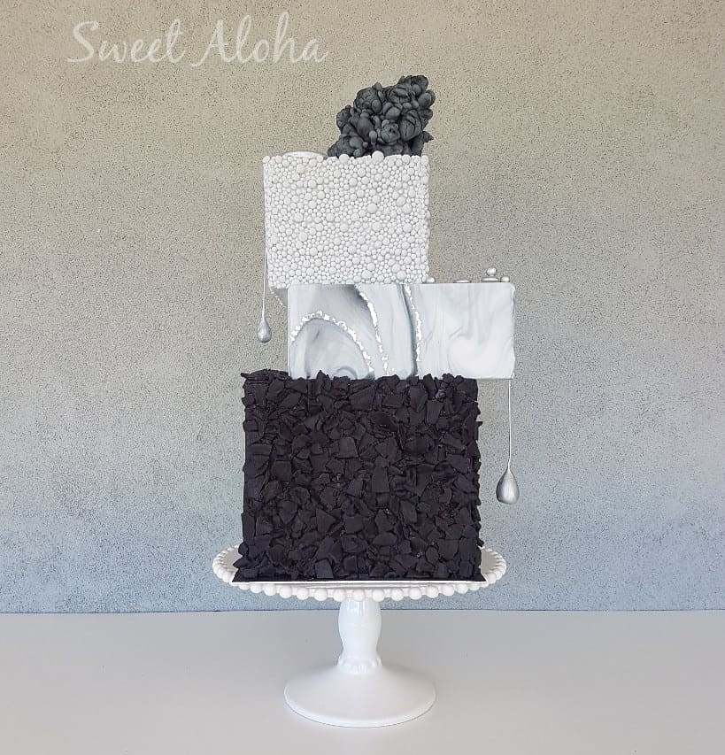 Gray and black textured ruffled fondant wedding cake