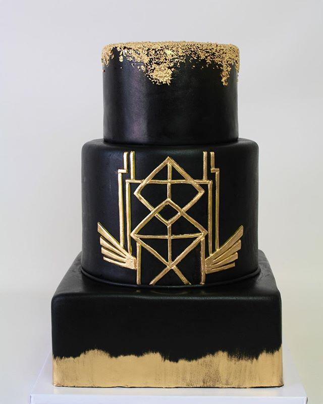 All black gatsby themed fondant wedding cake with gold