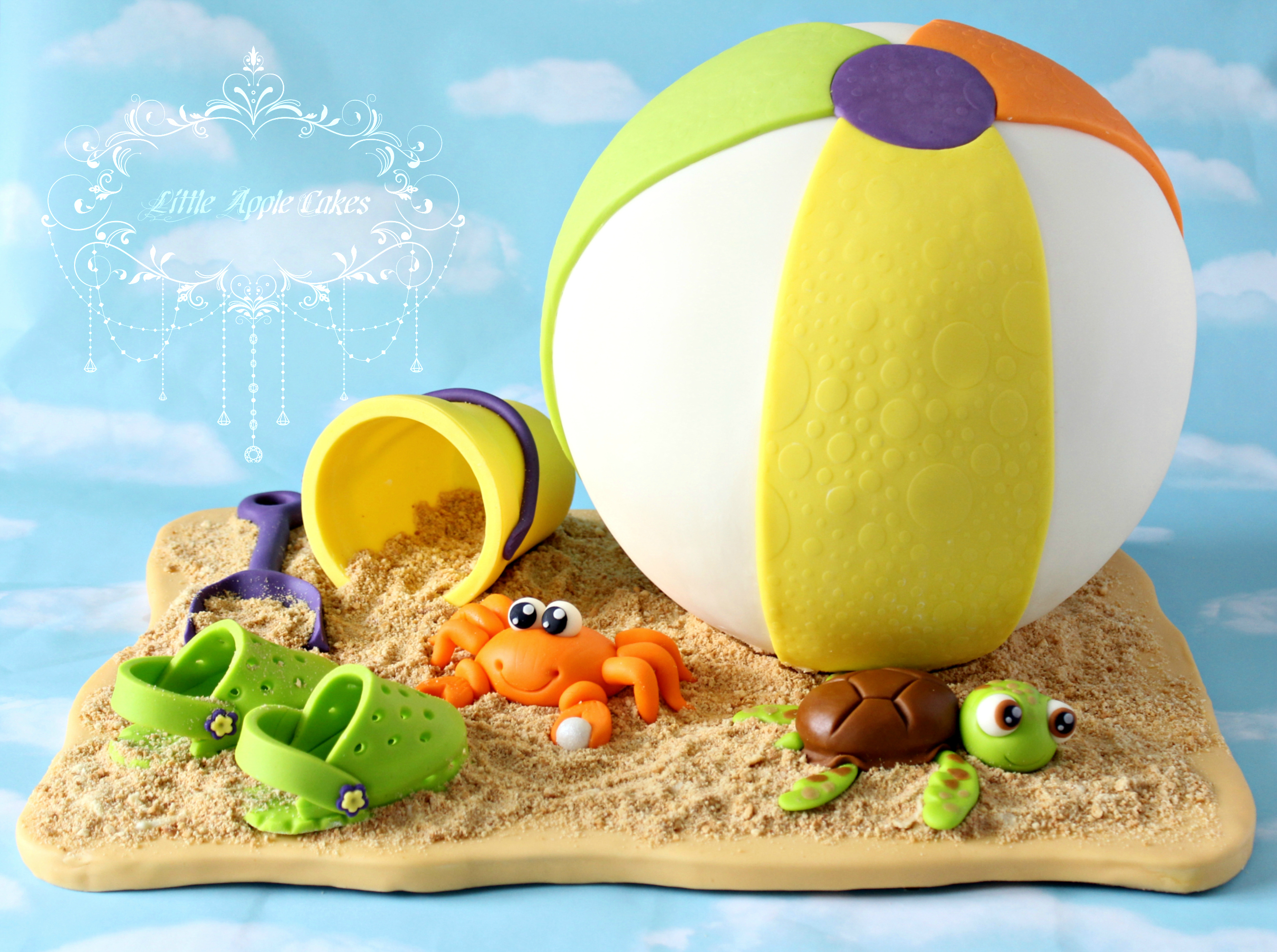 Beach Ball and sand toys fondant cake