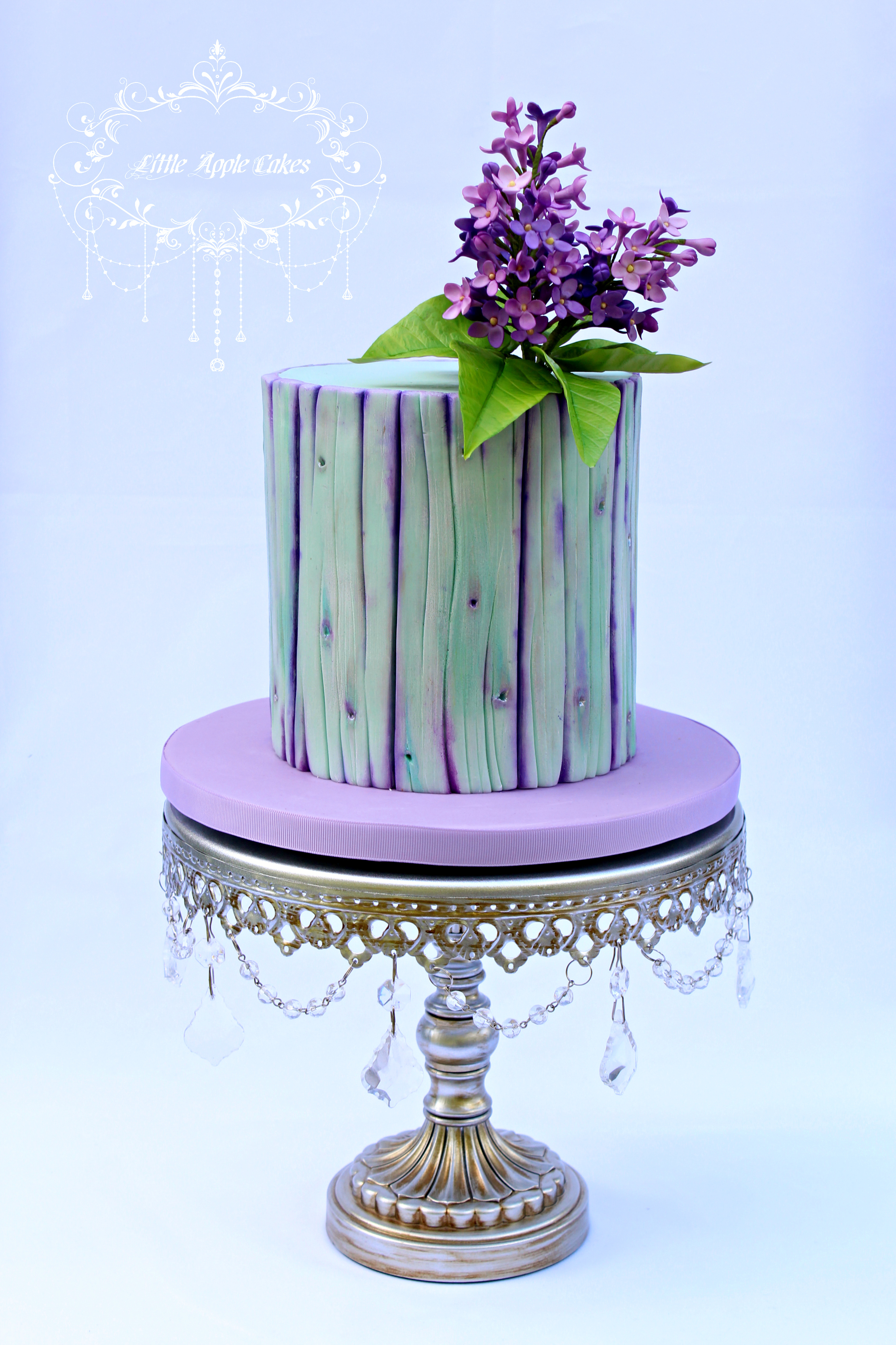 Purple barrel wedding cake with sugar flowers