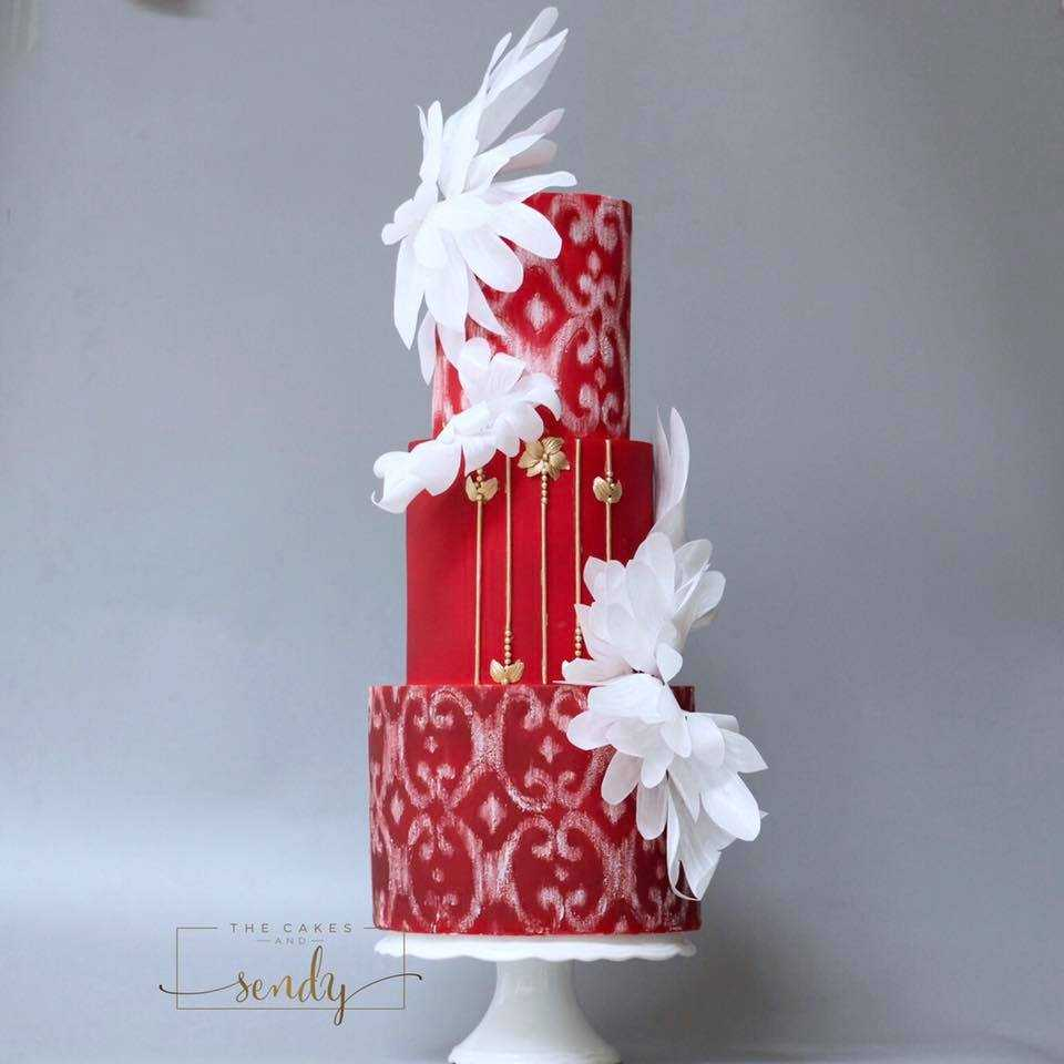 All red fondant wedding cake with white florals