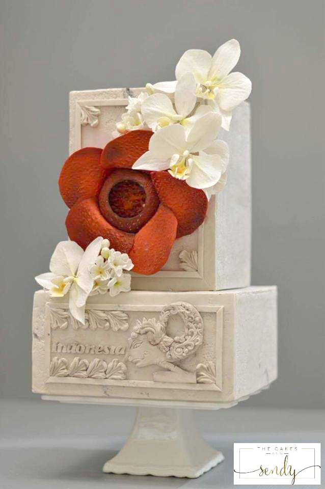 Ivory stone like wedding cake with red sugar flower