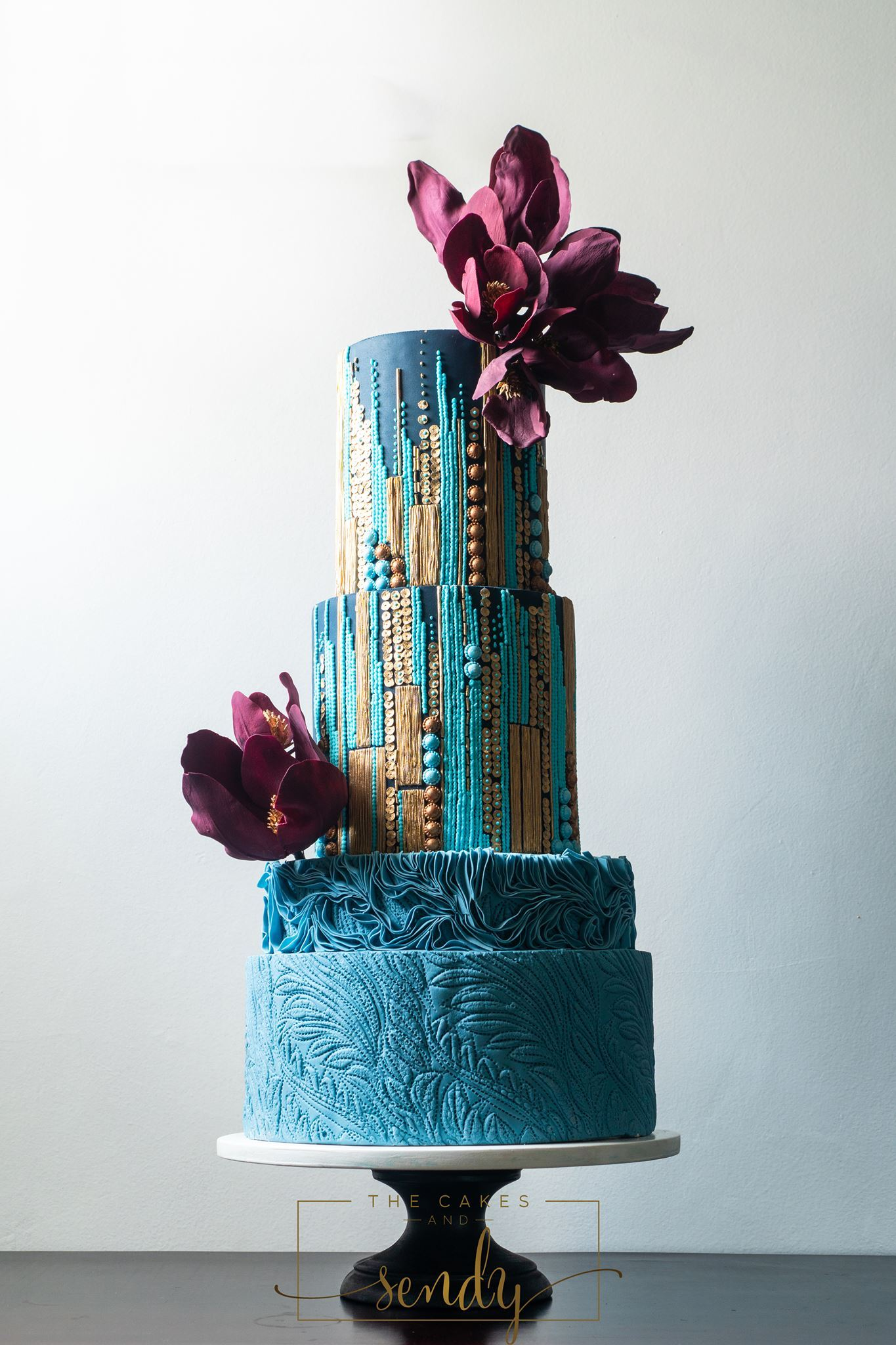 Turquoise and blue modern fondant wedding cake