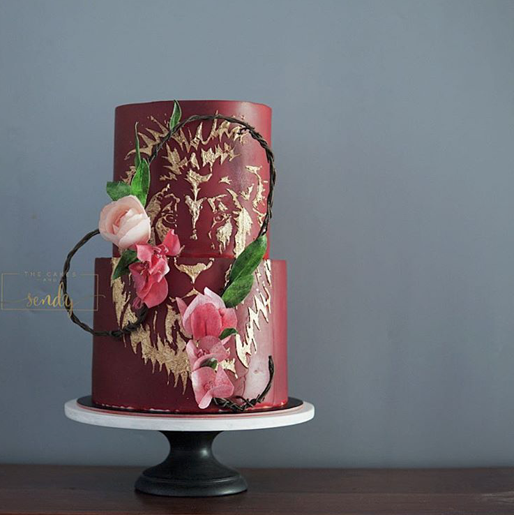 Dark red batik fondant wedding cake