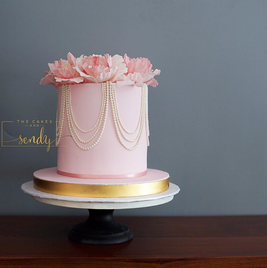 Elegant baby pink fondant cake with sugar pearls