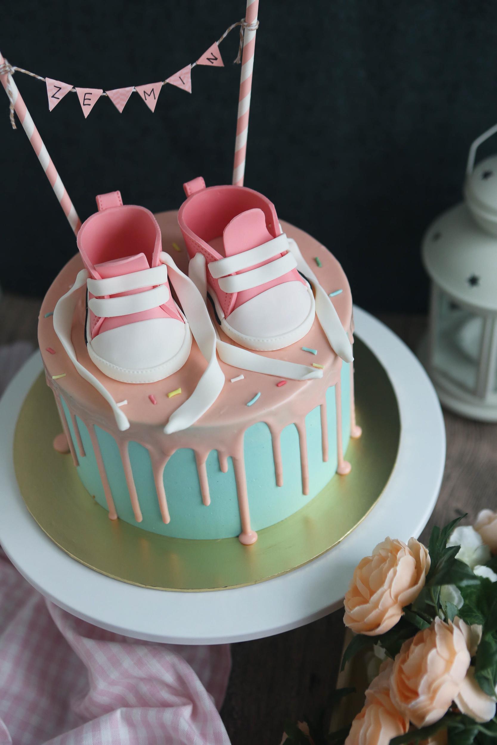 Pink baby shoe fondant cake