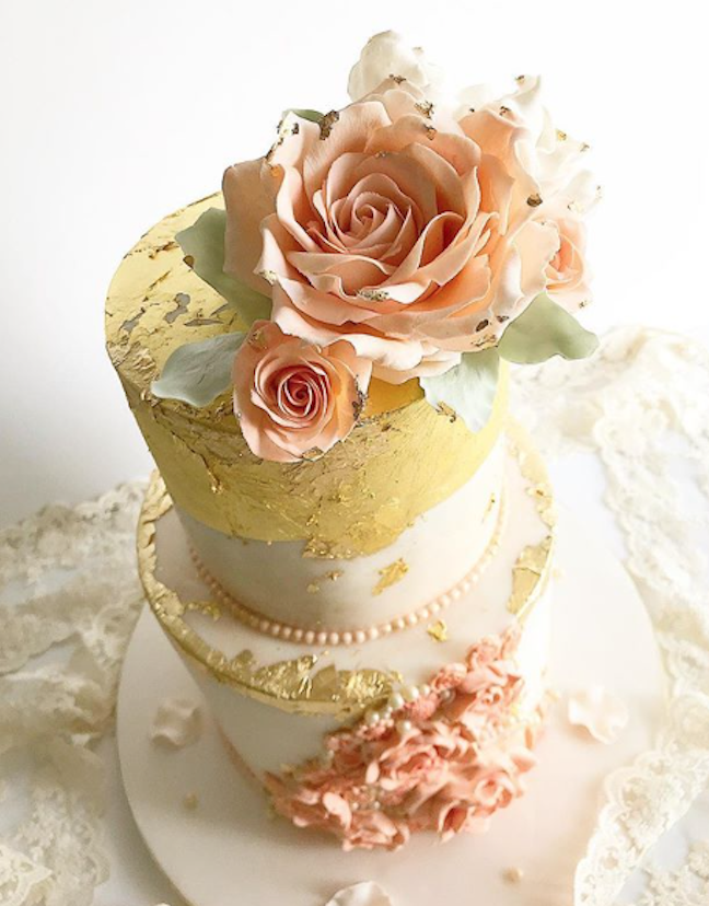 Rose gold fondant wedding cake with peach gum paste flowers