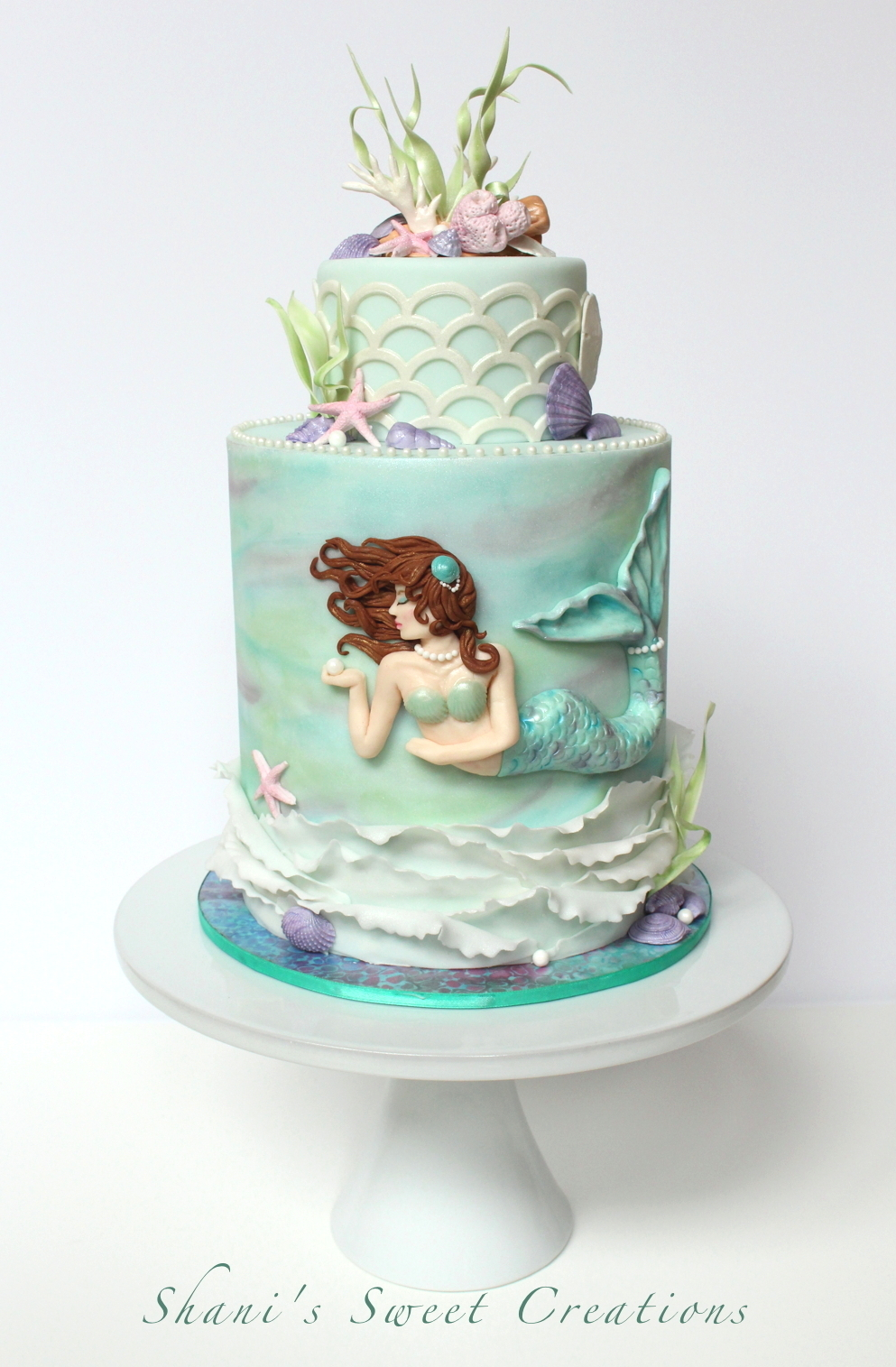 pastel green mermaid cake